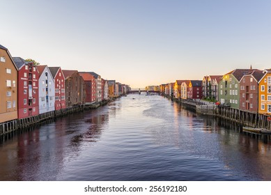 Old wooden colorful seahouses by Nidelven river in Trondheim, Norway.