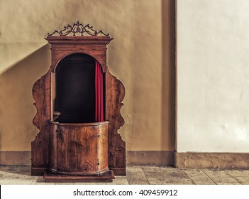 Old wooden confessional in Italy