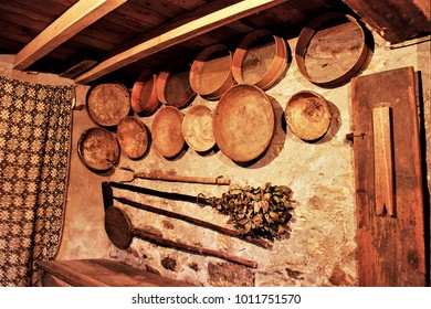old wooden containers,old country kitchen with hanging pans,old wooden cupboard in the kitchen of a rural house in Galicia, old wooden furniture,  typical rural cuisine of Galicia, old baker's tools