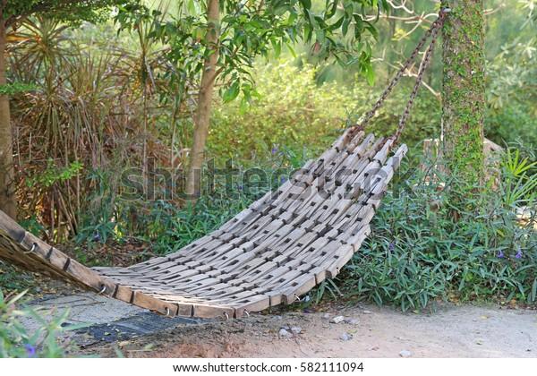 old wooden cradle in garden