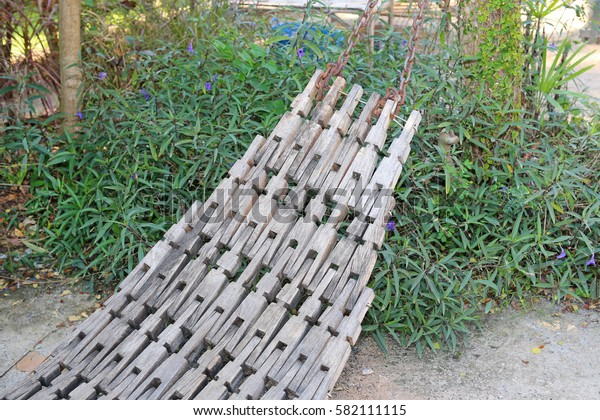 old wooden cradle in garden