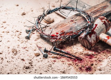 Old wooden cross, hammer, bloody nails and crown of thorns on ground. Banner. Copy space. Good friday. Passion, crucifixion of Jesus Christ. Christian Easter holiday. Gospel, salvation.