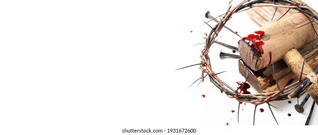 Old wooden cross, hammer, bloody nails and crown of thorns isolated on white background. Copy space. Good friday. Passion, crucifixion of Jesus Christ. Christian Easter holiday. Gospel, salvation.