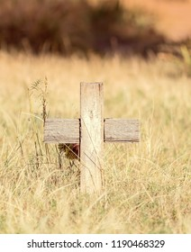 Old Wooden Cross in a Historic Cemetery with Beautiful Grassy & Tree Filled Backgrounds in a Peaceful Setting