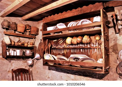 old wooden cupboard in the kitchen of a rural house in Galicia, old wooden furniture, old food storage containers, typical rural cuisine of Galicia, Galician ethnographic museum,
