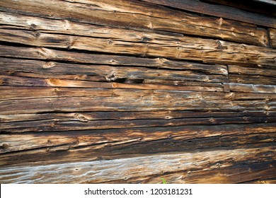 old wooden dark brown boards forming an original natural background