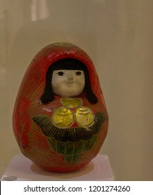 Old wooden Daruma doll in female form. Roly-poly toy - Japanese gift for success & good luck.