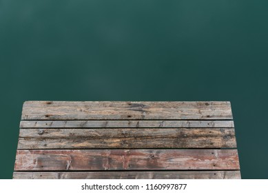 Old wooden deck in the lake.