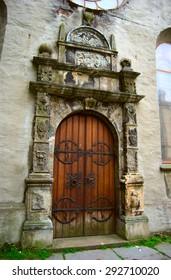 Old wooden door, ancient building, Bergen, Norway