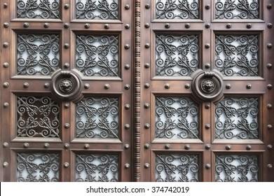 Old wooden door background texture close up