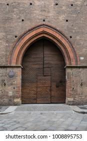 Old wooden door. Bologna medieval city, Italy.