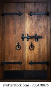 Old wooden door with a bolt and a lock