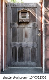Old wooden door with old wooden box mail of house.
