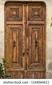 Old wooden door with carving. Catalonia