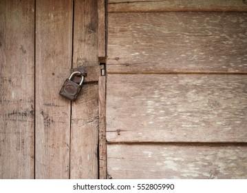 Old wooden door with Chain key lock