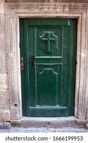 Old wooden door in the old city of Kotor, Montenegro