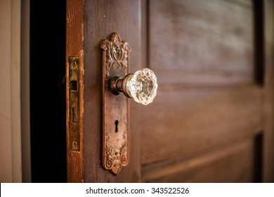 Old wooden door with a crystal door knob.