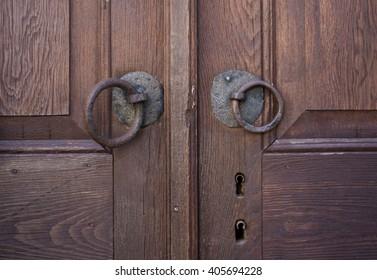 Old Wooden Door Detail With Rusty Ring Doorknobs