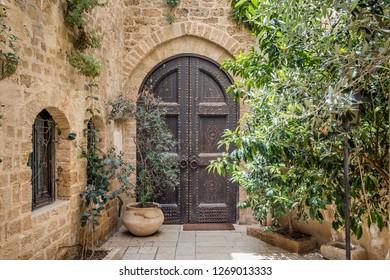 Old wooden door. Entrance to the old building in Tel Aviv, Israel.