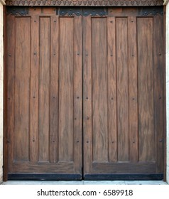 An old wooden door at the entrance of an old church.