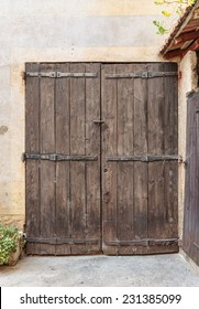 Old wooden door in the entrance stone French house