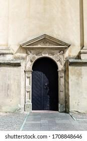 Old wooden door, facade of building. Vintage exterior, door with doorrknob.