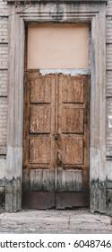 Old wooden door in fake paint. The door on the city street