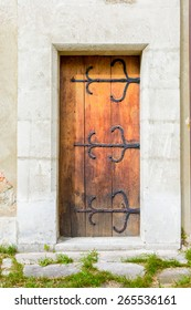 Old wooden door with forged elements