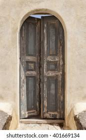 Old wooden door green in Santorini