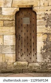old wooden door inside a castle