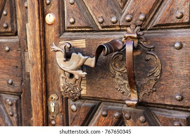 old wooden door with an iron handle