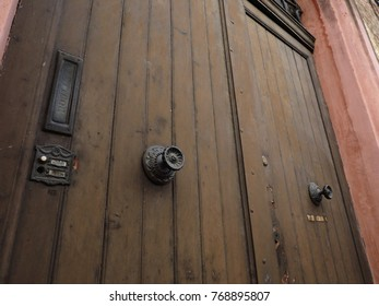 """Old wooden door. Italian mail box, handles and doorbell. """"Lettere"""" means mail."""
