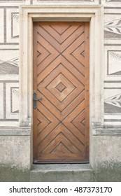 Old wooden door in italian palazzo
