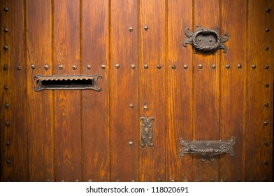 Old wooden door with mail box