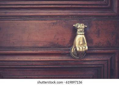 Old wooden door with a metal handle in Rethymnon