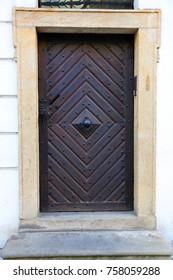 old wooden door with metal rivets