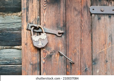 Old wooden door with metallic doorlock