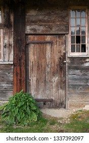 Old wooden door at Naunton, Cotswolds, Gloucestershire, England