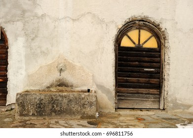old wooden door near a fountain