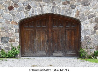 Old wooden door nestled in a stone wall
