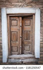 Old wooden door on a brick wall.