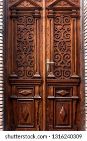 Old wooden door with ornaments, close up