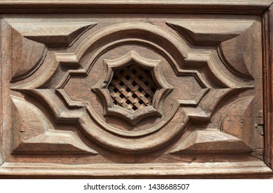 Old wooden door peephole with grid texture background