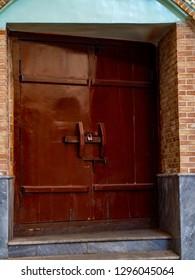 The old wooden door of the Qajar mosque of Sheikh Abdolhossein in Tehran, Iran