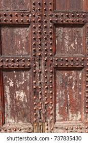 Old wooden door with rivets