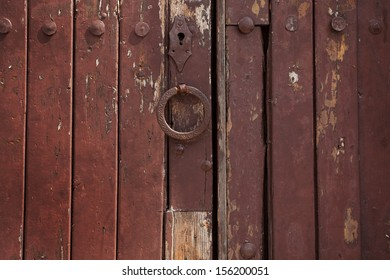 Old wooden door with rivets and a handle