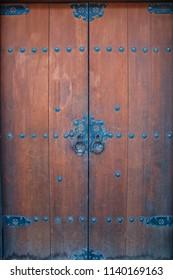 Old Wooden Door With Round Iron Handles
