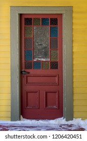 Old wooden door with stained glass.