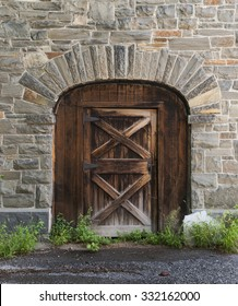 Old Wooden Door in a Stone Barn Wall