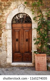 Old wooden door in Tuscany, Italy